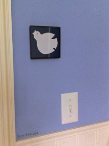 framed dove applique on wall