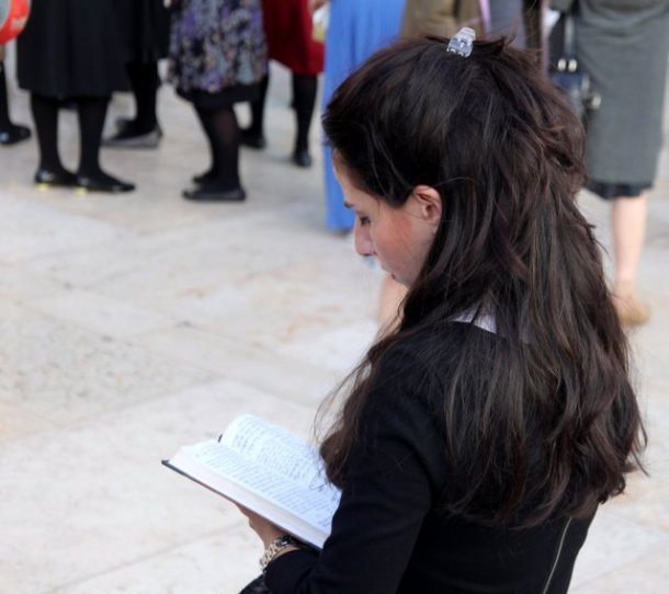 Jewish woman praying at Western Wall