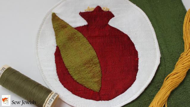 A little pomegranate of hand appliqued silk sew jewish