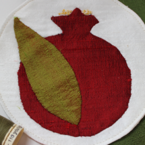 A little pomegranate of hand-appliqued silk
