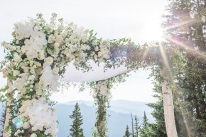 Get inspired by this Aspen wedding chuppah with a mountain view