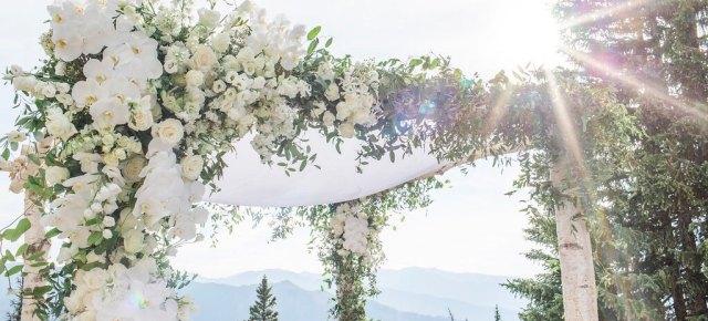 Silk chuppah canopy with white flowers