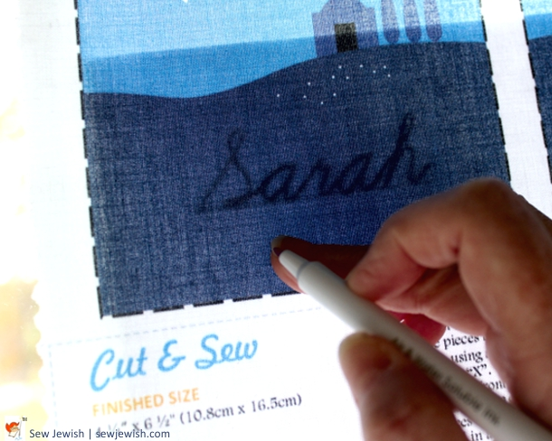 Tracing name embroidery pattern onto fabric