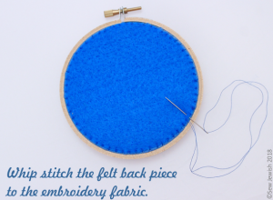 whip stitch felt back piece to embroidery fabric