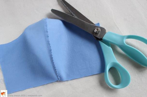 Trim seam allowance with pinking shears